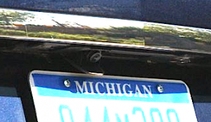 You can see once camera just above the C on the license plate.