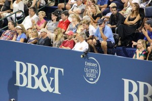 Brooklyn Decker, Roddick's wife, sitting above the T