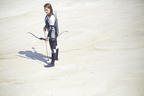 HGUFT_Staff_member_Emma_Moore_as_katniss_at_cornucopia_courtesy_of_Hunger_Games™_Unofficial_Fan_Tours,_staff_photographer_Aliya_Smith.