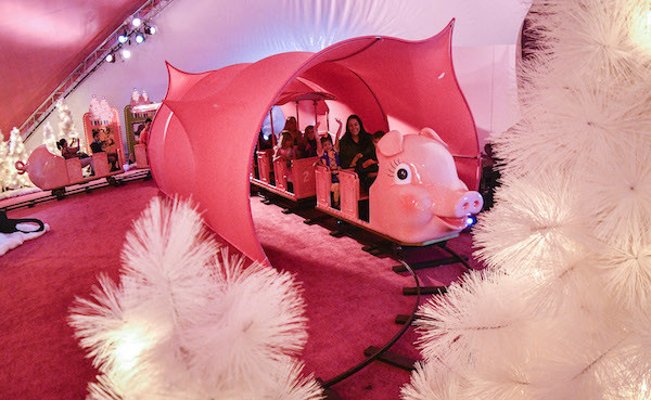 Patients from the Children's Healthcare of Atlanta enjoy a ride on the Macy's Pink Pig at Macy's Lenox Square Mall in Atlanta, on Wednesday, Oct. 26, 2016. From its debut in the '50s as a children's ride, five generations of Atlantans have ridden the Macy's Pink Pig into the holiday season. (John Amis/AP Images for Macy's)