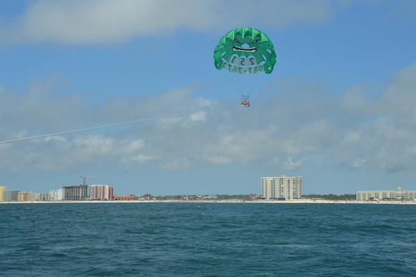 Parasailing with beach and condos in background
